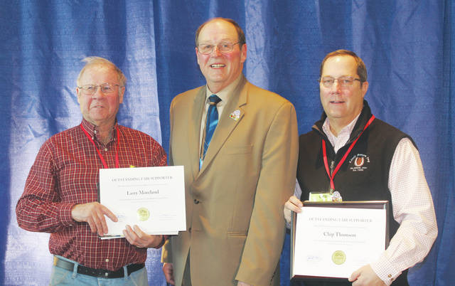 Delaware County Agricultural Society Board of Directors member Larry Moreland, left, is shown with Ohio Department of Agriculture Director David T. Daniels, center, and Delaware County Agricultural Society board member Chip Thomson, right, at the 93rd Ohio Fair Managers Association annual convention at the Greater Columbus Convention Center. Moreland and Thomson each received awards for their work on behalf of the Delaware County Fair.