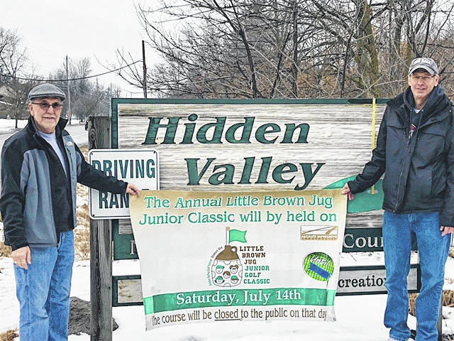Kiwanis Club of Delaware County President Ed Schlote, left, and Jeff Hall, a past club president, hold up a banner announcing the date of the annual Little Brown Jug Junior Golf Classic, which will be held July 14 at the City of Delaware's Hidden Valley Golf Course on West William Street.