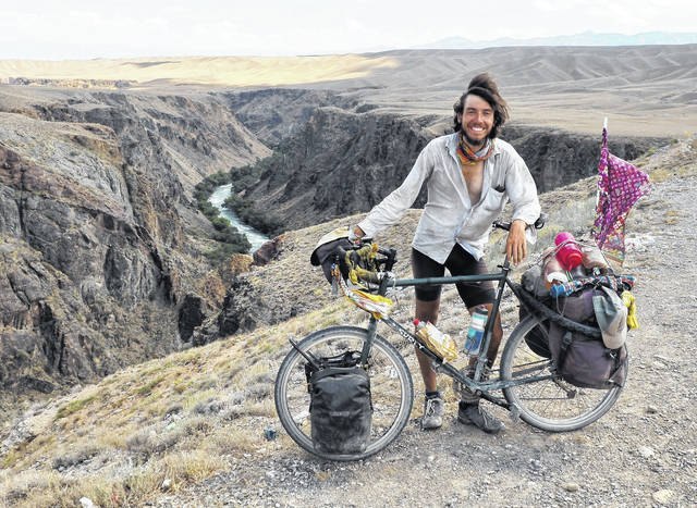 Liberty Township native Luke Miller spent the last year-and-a-half bicycle touring 15,000 miles across Asia. Miller is pictured along with his bicycle in Kazakhstan. Miller plans to spend another year-and-a-half touring the world on his bicycle.