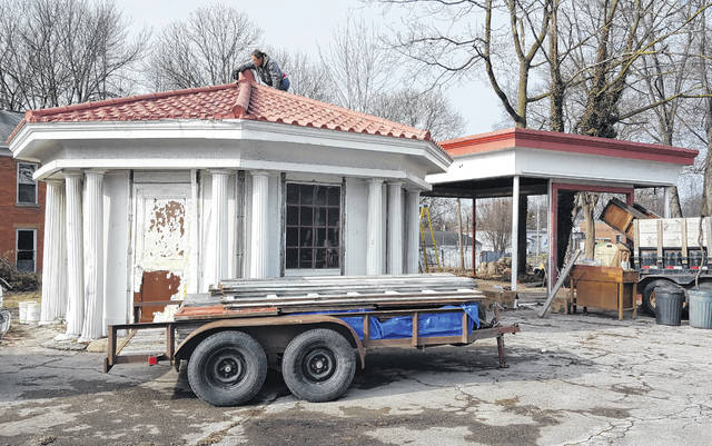 The octagon building and service garage of the former filling station at the corner of Lake Street and Central Avenue in Delaware are being dismantled and will be moved to Kansas and Missouri, respectively. Ben Eckart of Kansas and Lee Hoover of Missouri are collectors of vintage filling stations and are taking the buildings to their new homes to preserve them.