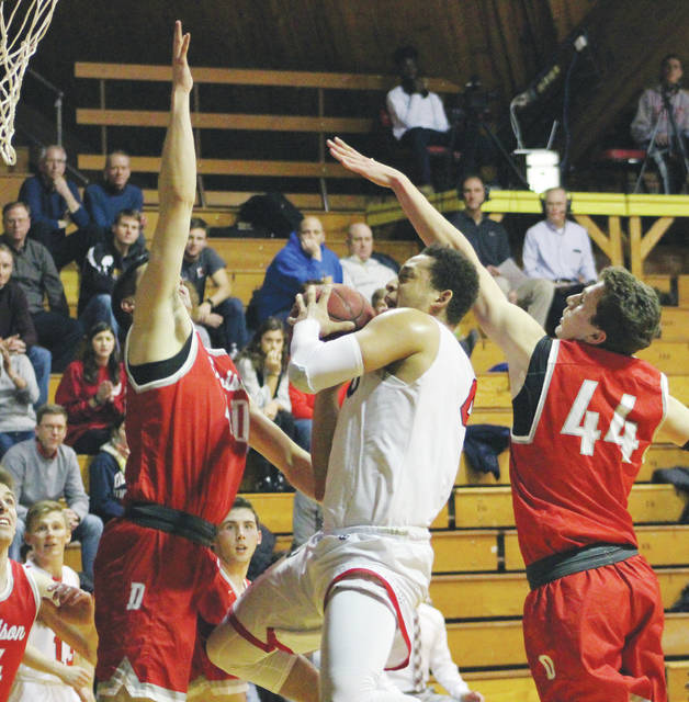 OWU's Seth Clark slices between a pair of Denison defenders for a layup during the first half of Wednesday's NCAC showdown at Branch Rickey Arena in Delaware.