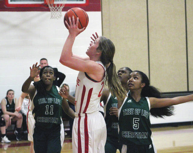 Delaware Christian's Lyssi Snouffer, center, shoots during the first half of Thursday's MOCAL showdown against visiting Tree of Life.