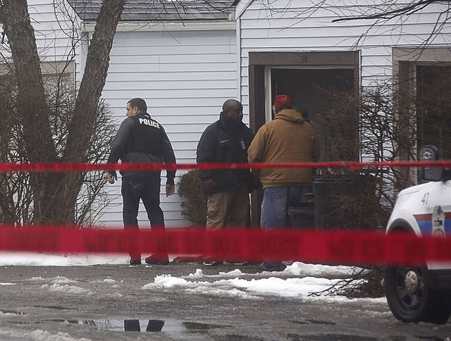 Police investigate the scene of a shooting in Westerville, Ohio, on Saturday, Feb. 10, 2018.  Westerville police have confirmed that two officers have been fatally shot at a home in the Columbus suburb.  A police statement says the officers responded to a 911 hang-up call around 11:30 a.m. and were shot after they arrived at a residence.  A suspect is reportedly in custody.    (Tom Dodge/The Columbus Dispatch via AP)