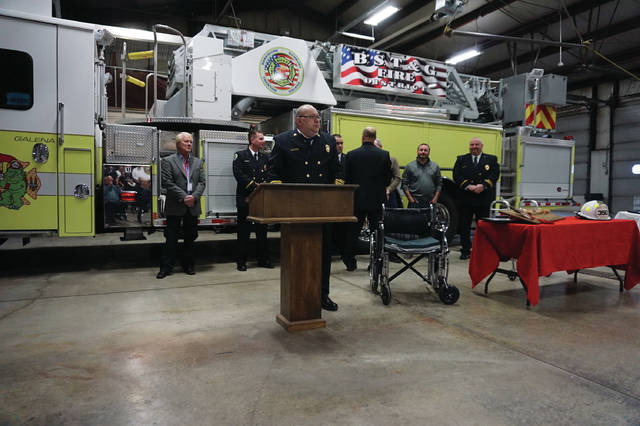 BST&G Fire Chief Jeff Wilson prepares to speak at his retirement in the district's station at 350 W. Cherry St. in Sunbury on Jan. 31. On the table to the right of Wilson is a ceremonial fire ax that was presented to him.