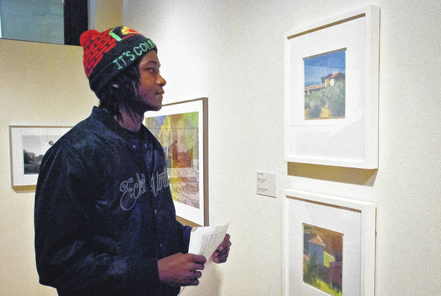 Zion Sims, like many Ohio Wesleyan University art students, walked around in the Ross Art Museum Wednesday in search of the piece of art to feature in his first art history paper. Zion said the professor was asking for a visual analysis and what the artist's intent was for creating the piece.
