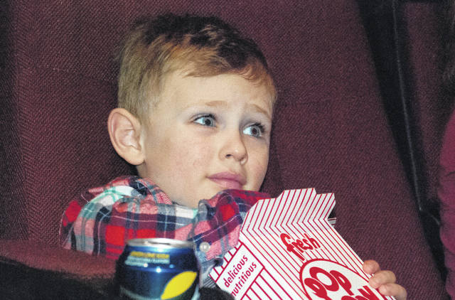 """With his eyes open as wide as they could go, Linden Smieszek, 5, munched on some popcorn as he waited for """"Peter Rabbit"""" to start Monday afternoon at the Strand Theatre. He said he was happy to be there for the movie."""