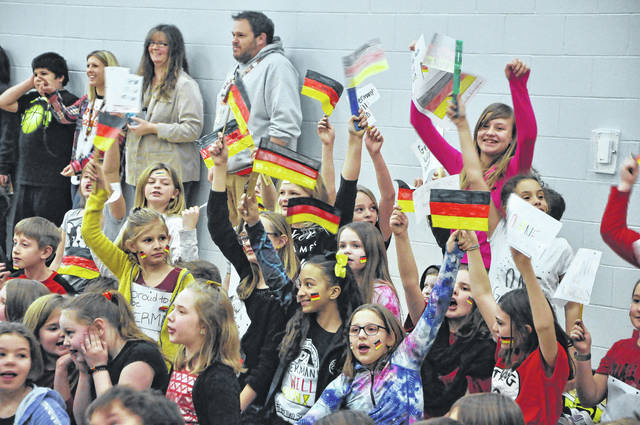 """Smith students from Team Germany cheer during the kick off for the Reading Olympics Friday afternoon. For the next two weeks, students will be asked to keep track of how many minutes they read. The """"country"""" with the most minutes gets a special prize"""