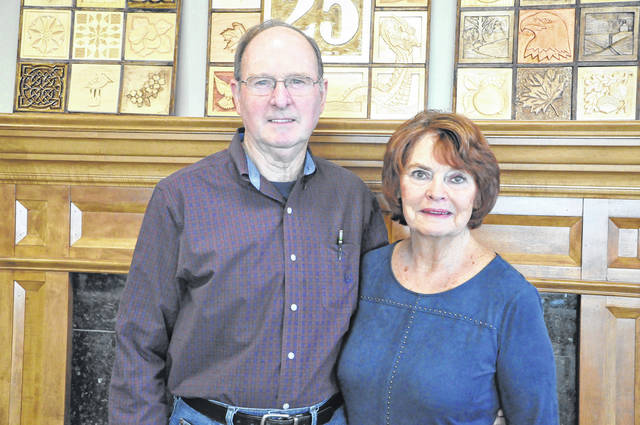 Sunbury couple Bob Kelley and Judy Silverthorn pose in front of the fireplace at SourcePoint. Kelley said they went on their first date at a Columbus Clippers game six months ago.