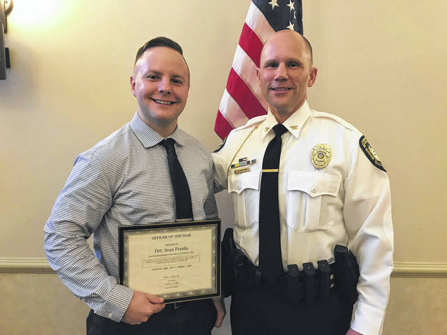 Detective Sean Franks poses with City of Delaware Police Chief Bruce Pijanowski after receiving the Officer of the Year award on Feb. 20.
