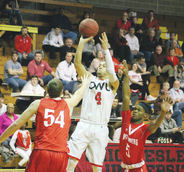 Ohio Wesleyan's Seth Clark (4) puts up a shot between Wittenberg's Connor Seipel (54) and Rashaad Ali-Shakir (5) during the first half of Wednesday's NCAC showdown at Branch Rickey Arena.