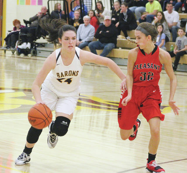 Buckeye Valley's Hannah Cowan drives by Pleasant's Erika Linder (32) during the first half of Tuesday's MOAC showdown in Delaware.