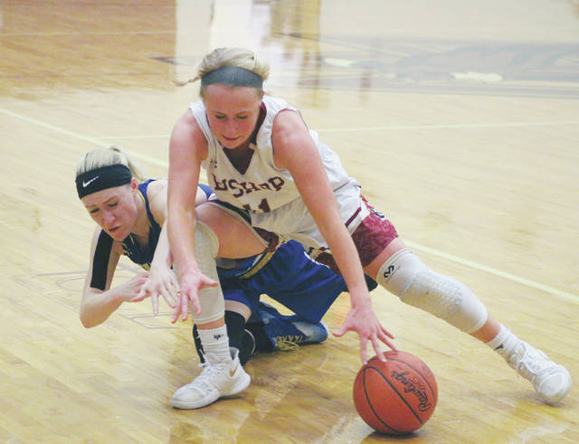 Watterson's Paige Woodford, front, and Olentangy's Grace Pennington battle for possession during the first half of Thursday's Division I District Tournament game in Columbus.