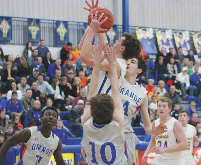 Olentangy's Alex Sieve puts up a shot between Orange's Ryan Cutler (4) and Bryson Lane (10) during the first half of Friday's OCC showdown in Lewis Center.