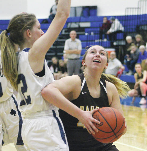 Buckeye Valley's Tess Hughes, right, works against Granville's Isabella Yeager during the first half of Tuesday's Division II district semifinal at Highland High School.