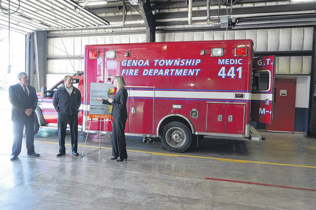 State Chief Deputy State Fire Marshal Bill Spurgeon (left), Genoa Township Fire Chief Gary Honeycutt (middle), and Ohio Bureau of Workers' Compensation Administrator/CEO Sarah Morrison (right) discuss a grant the township received for firefighter safety during an event held Tuesday.