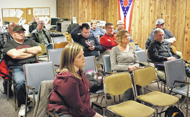 Ostrander residents listen to a presentation given by village council member Robert Taylor explaining the reason why council enacted a 1 percent income tax in the village. An ordinance was approved by council on July 11, 2016, for a 1 percent income tax that took effect in January 2017. Since that time, a group residents have circulated a petition asking for a referendum on the May ballot to overturn council's decision.