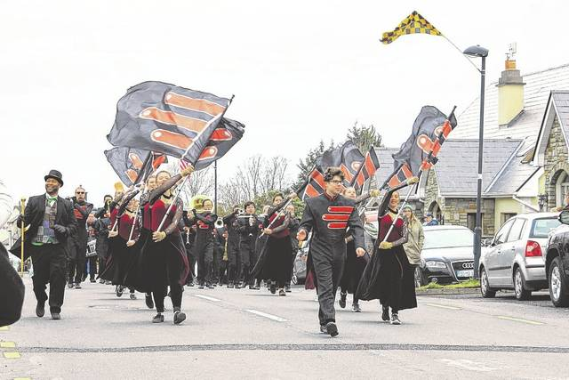 The Delaware Hayes High School Marching Band performs in the Lahardane St. Patrick's Day Parade on March 17.