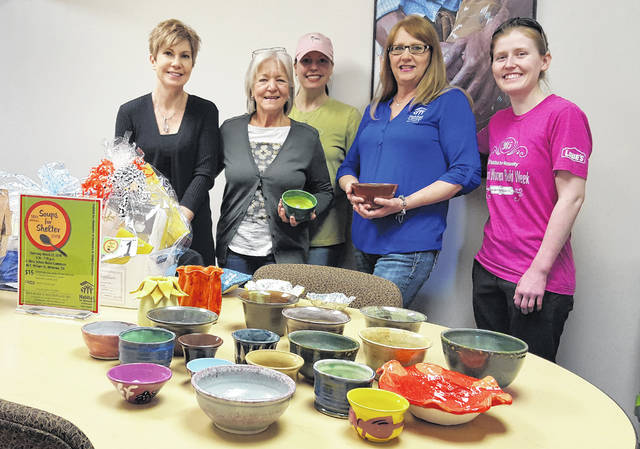 Pictured with some of the bowls that will be available on Thursday, March 22 during Habitat for Humanity of Delaware & Union Counties' 16th annual Soups for Shelter event are members of the Soups for Shelter Committee.