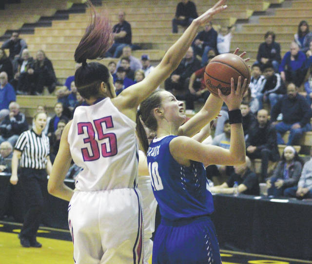 Olentangy Liberty's Lauren Spicer is defended by Pickerington Central's Adrian Crockwell (35) during the first half of Saturday's Division I district championship at Ohio Dominican University's Alumni Hall.
