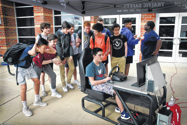 In an attempt to keep local teens safe behind wheel, AAA partnered with SAFE Delaware County to hold a teen driver safety event at Olentangy Orange High School on Friday. Students were able to have their cars checked for possible safety issues, sign a pledge to Slow Down!, and drive a distracted driving simulator. As Gabriel Habel, pictured, took the wheel of the simulator, many of his friends stood behind him offering advice on how to handle the surprising situations as they popped up.