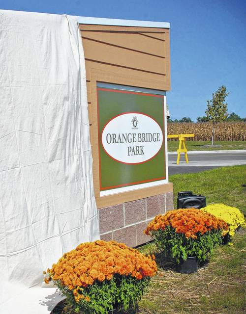 Orange Bridge Park was dedicated Sunday, Oct. 9 by the Orange Township trustees and park board. The veiled sign was slowly revealed displaying the name of the 1.5-acre park that sits next to the foot bridge crossing U.S. 23. The name received the majority of the votes from residents in a contest held by township officials. The photo was taken the day of the dedication.