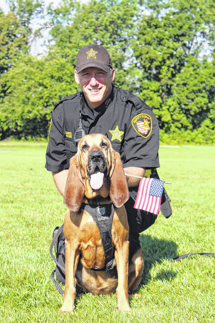 Deputy Scott Gaines with bloodhound Lacy, who retired last week.