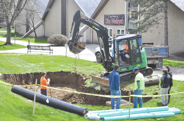 Crews work Monday on removing land to create space for a spring garden to be located just outside the main doors to Branch Rickey Arena on the Ohio Wesleyan University campus.