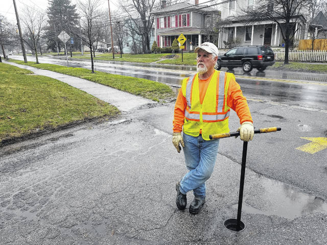 Water Distribution Technician Brad Smith on the job Thursday morning on Central Avenue. Smith said he's been with the city since 1987 and has enjoyed getting to know all the people in the city from the cab of a backhoe.