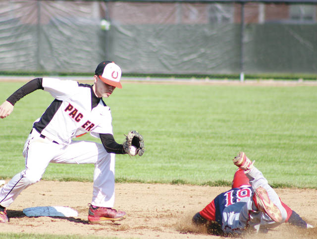 Delaware Hayes second baseman Cole Barton looks to tag out a Thomas Worthington base stealer during Thursday's OCC showdown in Delaware.