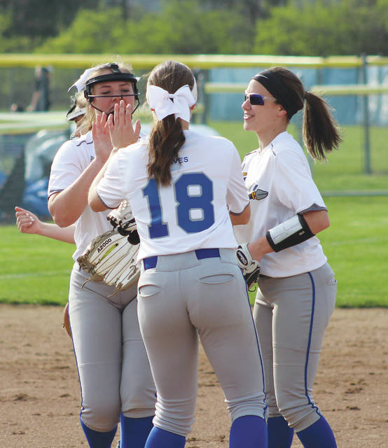 Braves players celebrate after pitcher Sophie Low, left, recorded a strikeout during Thursday's OCC showdown against visiting Westerville Central.