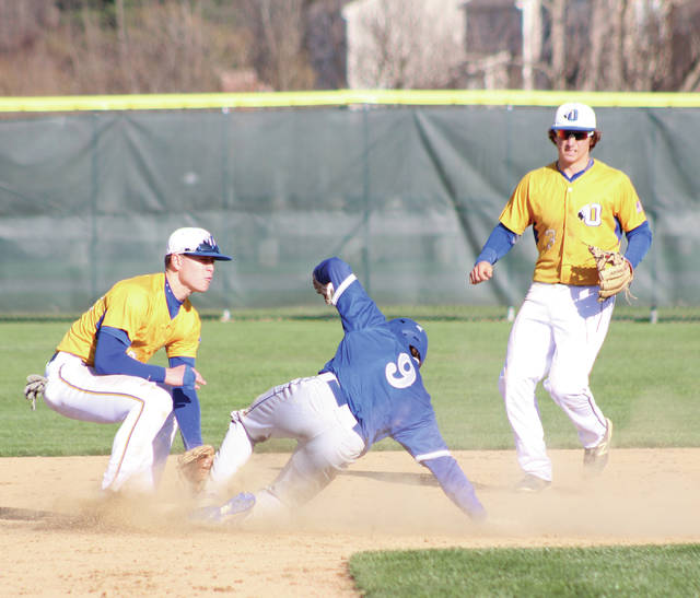 With Connor Haag (3) looking on, Olentangy's Josh Moeller tags out Olentangy Liberty's Brennan Rowe at second base during Friday's OCC showdown in Lewis Center.