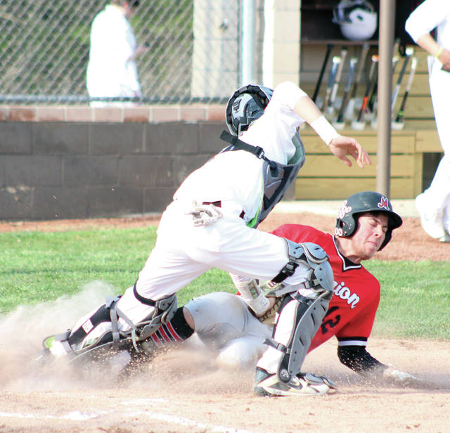 Buckeye Valley's Evan Ulrich tags out Marion Harding's Zach Wilson (12) during Wednesday's MOAC showdown in Delaware.