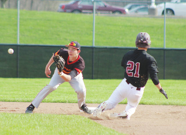 Big Walnut's Carson Becker waits for the ball before tagging out New Albany's Spencer Tammaro (21) at second base during Friday's OCC showdown in Sunbury.