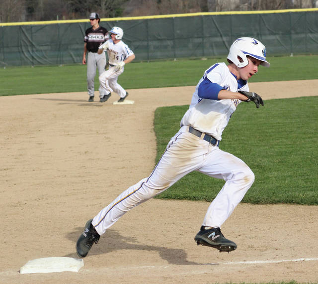 Olentangy's Connor McCulty rounds third base and heads for home during Friday's OCC showdown against visiting Westerville Central. The trail runner, Cole Robinson, went to third on the play.