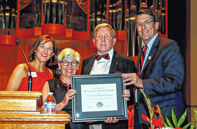 Ohio Wesleyan recognized Linda and C. Joseph Diamond, center, with an OWU Honorary Alumni Award during Reunion Weekend. Presenting the award to the Delaware couple are Sheila Fagan Plecha, Class of 1984, and President Rock Jones.