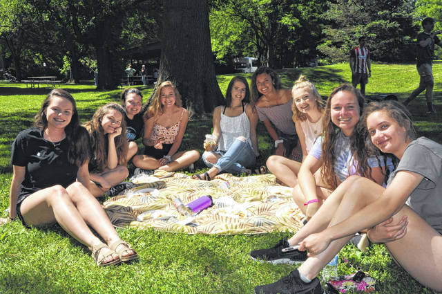 A group of seniors pose for a photo Thursday during the senior picnic at Mingo Park.