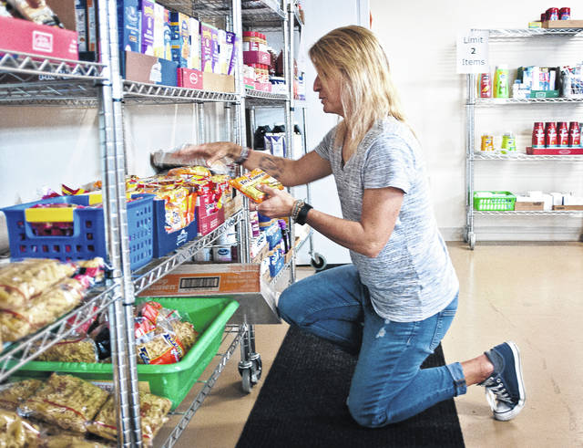Whether it's ordering food, buying food, picking up food, or keeping the shelves stocked, Amy Love, pictured, does it all as director of Buckeye Valley Food Pantry Inc. Love said keeping up with everything is a big job sometimes.