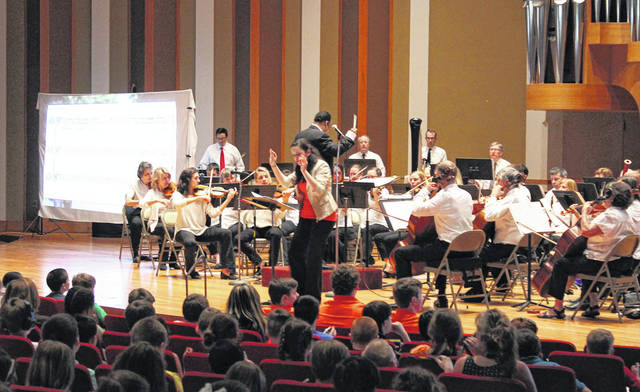 Kristen Basore, center, served as the host and song leader during a special performance on May 15 in which the Central Ohio Symphony welcomed some 900 fourth-graders from the city of Delaware and Delaware County for an interactive concert in OWU's David S. Gray Chapel.