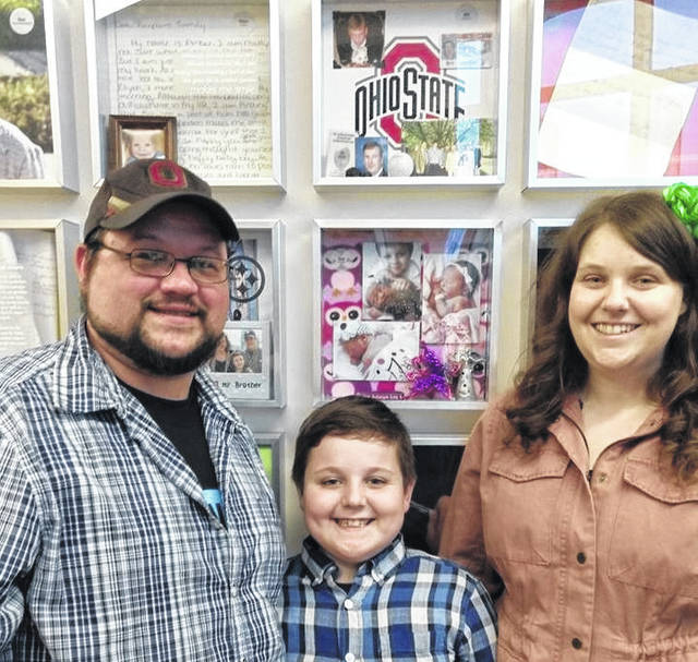 The Loy family of Delaware stands in front of baby Zoe's shadowbox located inside Lifeline of Ohio's headquarters on Kinnear Road in Columbus. Pictured, left to right, are Andrew Loy, Parker Loy and Kimberly Loy.