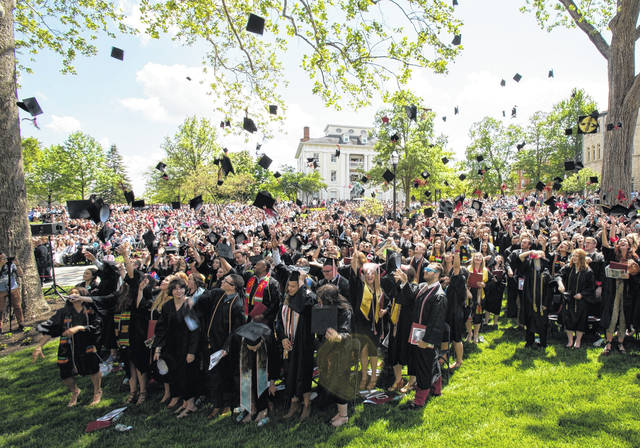 Ohio Wesleyan's 2018 commencement will be held at 1 p.m. May 12 on Merrick Lawn, outside Merrick Hall. Here, the Class of 2017 celebrates its just-completed graduation ceremony.