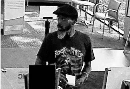 The Delaware Police Department posted this photo Monday afternoon and are asking the public for its help to identify this suspect who robbed the Huntington National Bank on East William Street. If you recognize this person, please call Detective Sgt. Mike Bolen at 740-203-1125.