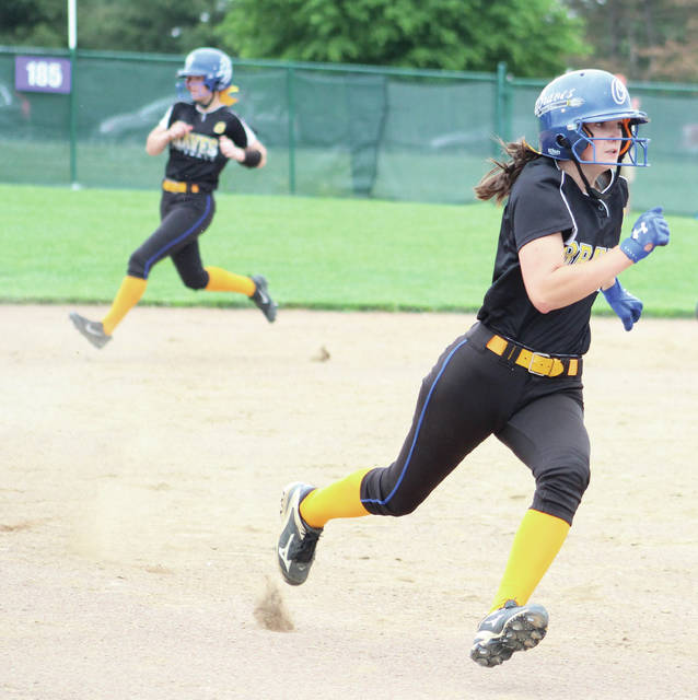 Olentangy's Emily Gernert rounds third base before scoring the first run in what was a 3-0 Division I district final win over Reynoldsburg Friday afternoon in Pickerington. Olivia Gregory, back, reached second on the play.