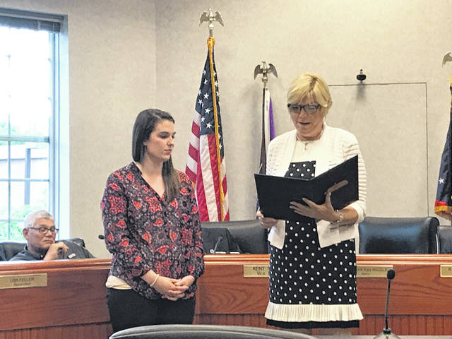 Mayor Carolyn Kay Riggle reads a proclamation to Lindsay Collins, assistant director of development for the Alzheimer's Association, Central Ohio Chapter, during Monday's Delaware City Council meeting.