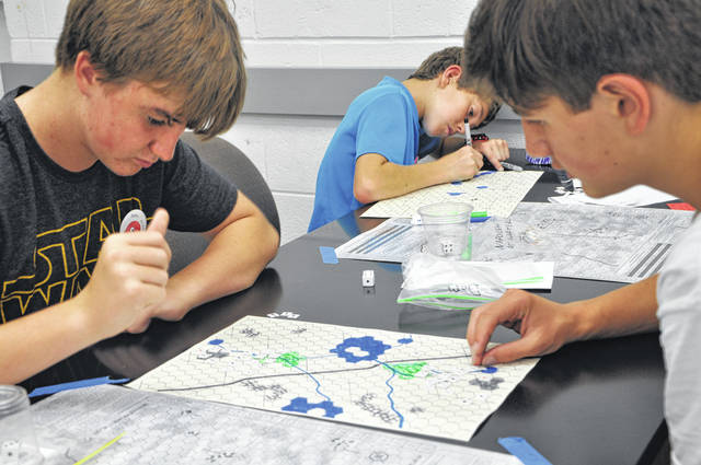 "Alex Zelen and Dominic DeFilippo face off in the Intro to Classical Wargaming course at the Ohio Wesleyan/Junior League of Columbus Camp on Friday. Zelen and DeFilippo created their own battlefield and units after learning the basics from the board game ""Napoleon at Waterloo."""