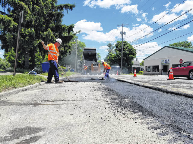 A City of Delaware street crew works on subsurface repairs to a section of East Central Avenue on Monday. The Central Avenue project will continue through August.