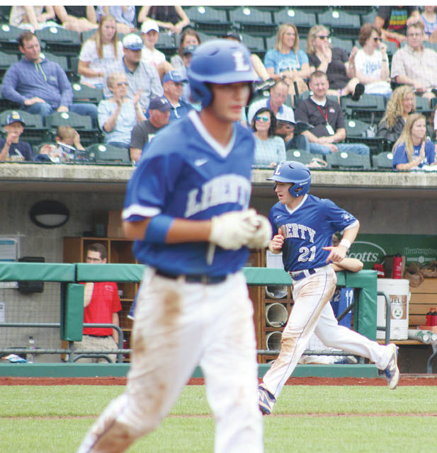 Liberty's Carson Comer (21) trots home as Corey Mayer heads to first after drawing a bases-loaded walk in the fifth inning of Friday's Division I state semifinal against Medina Highland at Huntington Park.