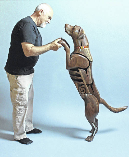 """Artist James Mellick meets his creation, Wounded Warrior Dog No. 4, """"Sniffer."""""""