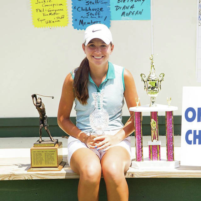Leila Raines poses with her trophy after winning the Ohio Junior Girls Championship Tuesday at Marion Country Club.
