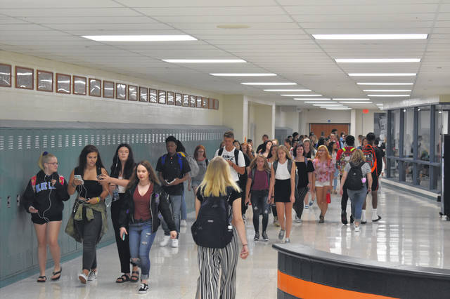 """Students at Delaware Hayes High School return to classes after lunch Wednesday during the first day of school. Principal Dr. Richard Stranges helped guide students to their classes and lockers and learn their new schedules. Stranges said making a good first impression on students """"sets the tone for the year."""""""