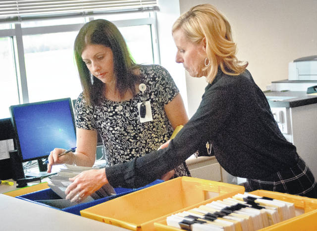 Delaware County Board of Elections on Monday held its official canvass of the Aug. 7 special election for the Ohio 12th Congressional District seat. BOE Manager Stephanie Clase, left, and BOE Director Karla Herron, right, look through the provisional ballots the board ruled on during Monday's canvass.